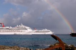 beautiful rainbow shines over the Grand Cayman port after... by Andrew Kubica